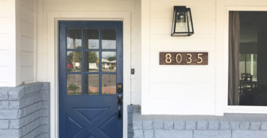 blue door gray brick white siding home exterior 8035