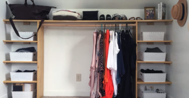DIY Dressing Room: closet with shelves organizing clothes, bins, and shoes