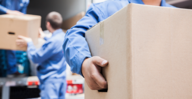 Packing and Unpacking - Best Packing Tips for Moving Day - Movers carrying boxes