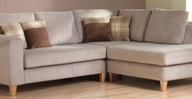 brown sectional sofa in empty home